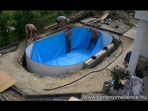 merevfalú medence felállítása